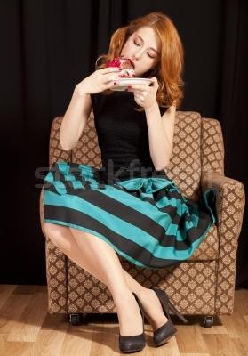 redhead-girl-eating-cake